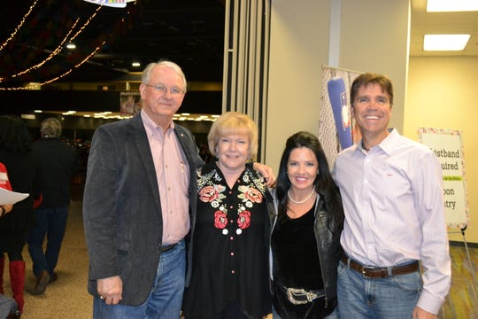 From left, Tom Dobson, Whataburger board chairman of the Board; Nora Dobson; D'Ann Hamon; and Eric Hamon, President/CEO of Driscoll Health System, pose for a photo during the 27th Fiesta de los Niños fundraiser for Driscoll Children's Hospital.