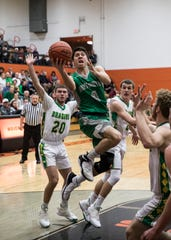 Huntington's Seth Beeler puts up a shot during a Division III sectional semifinal game in Waverly, Ohio in the 2018-19 season.