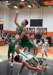 Huntington senior Elijah McCloskey goes up for a layup against West Union to score for Huntington during the third quarter of their Division III sectional semifinal game in Waverly, Ohio.