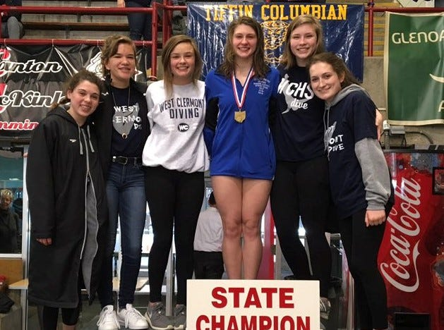 West Clermont senior diver Morgan Southall, center, won the Division I 1-meter diving championship Feb. 21 at C.T. Branin Natatorium.  She is surrounded by her West Clermont teammates.