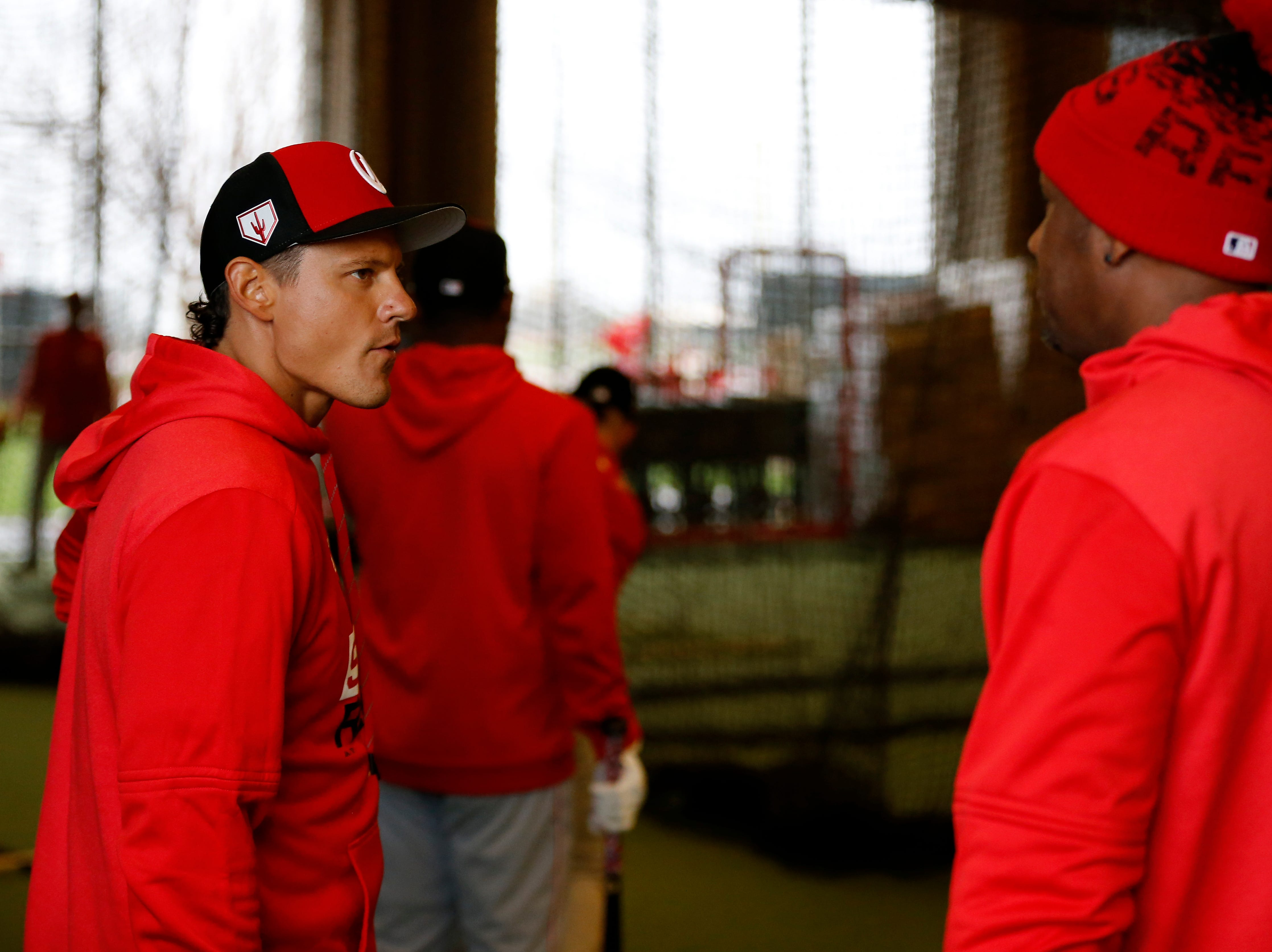 Cincinnati Reds new signee Derek Dietrich talks with Eric Davis at the Cincinnati Reds spring training facility in Goodyear, Ariz., on Thursday, Feb. 21, 2019.