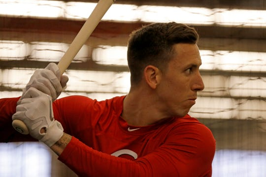 Cincinnati Reds relief pitcher Michael Lorenzen (21) takes batting practice at the Cincinnati Reds spring training facility in Goodyear, Ariz., on Thursday, Feb. 21, 2019.