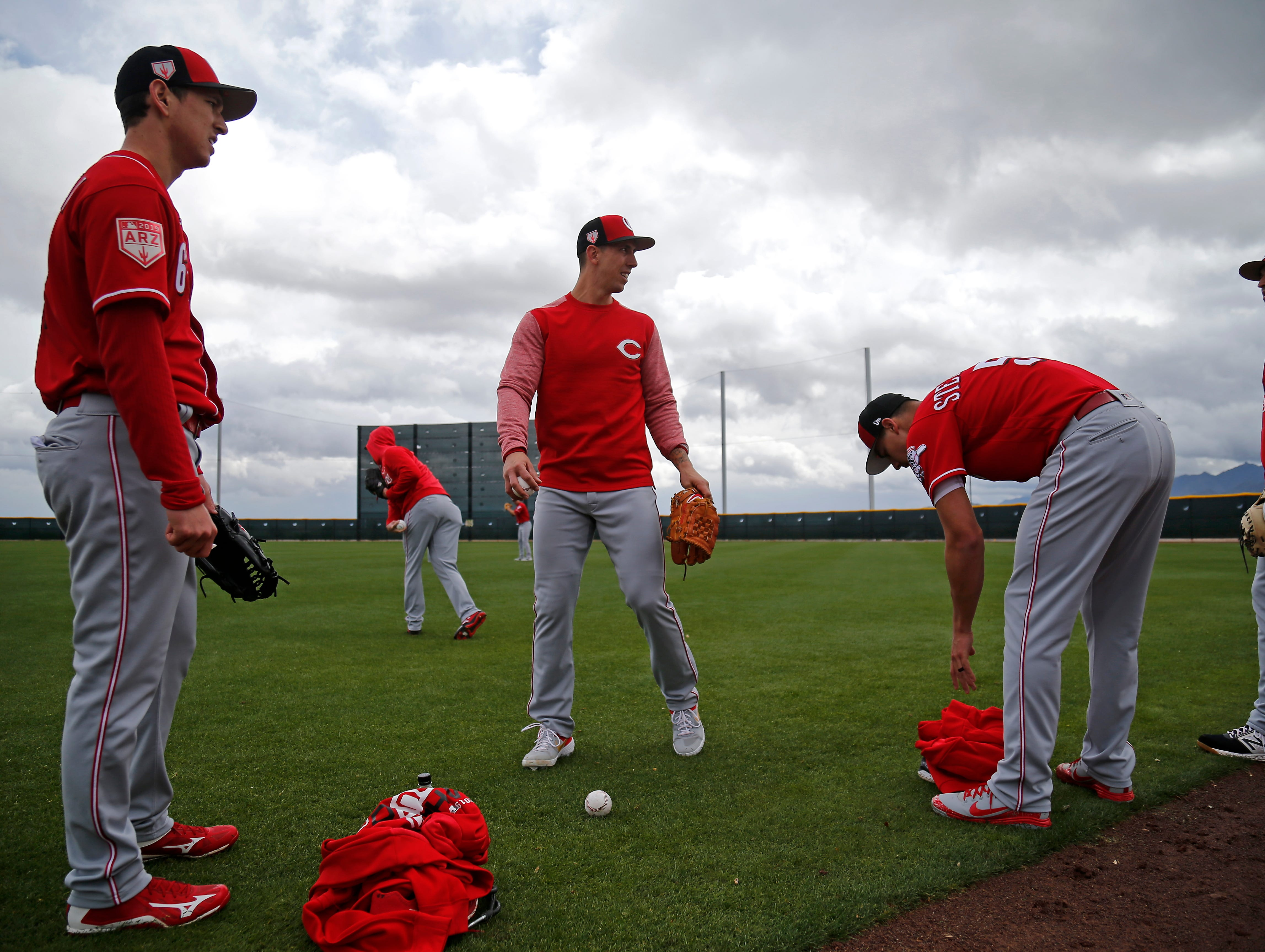 Cincinnati Reds relief pitcher Michael Lorenzen (21) talks with minor league pitchers after warming up at the Cincinnati Reds spring training facility in Goodyear, Ariz., on Thursday, Feb. 21, 2019.