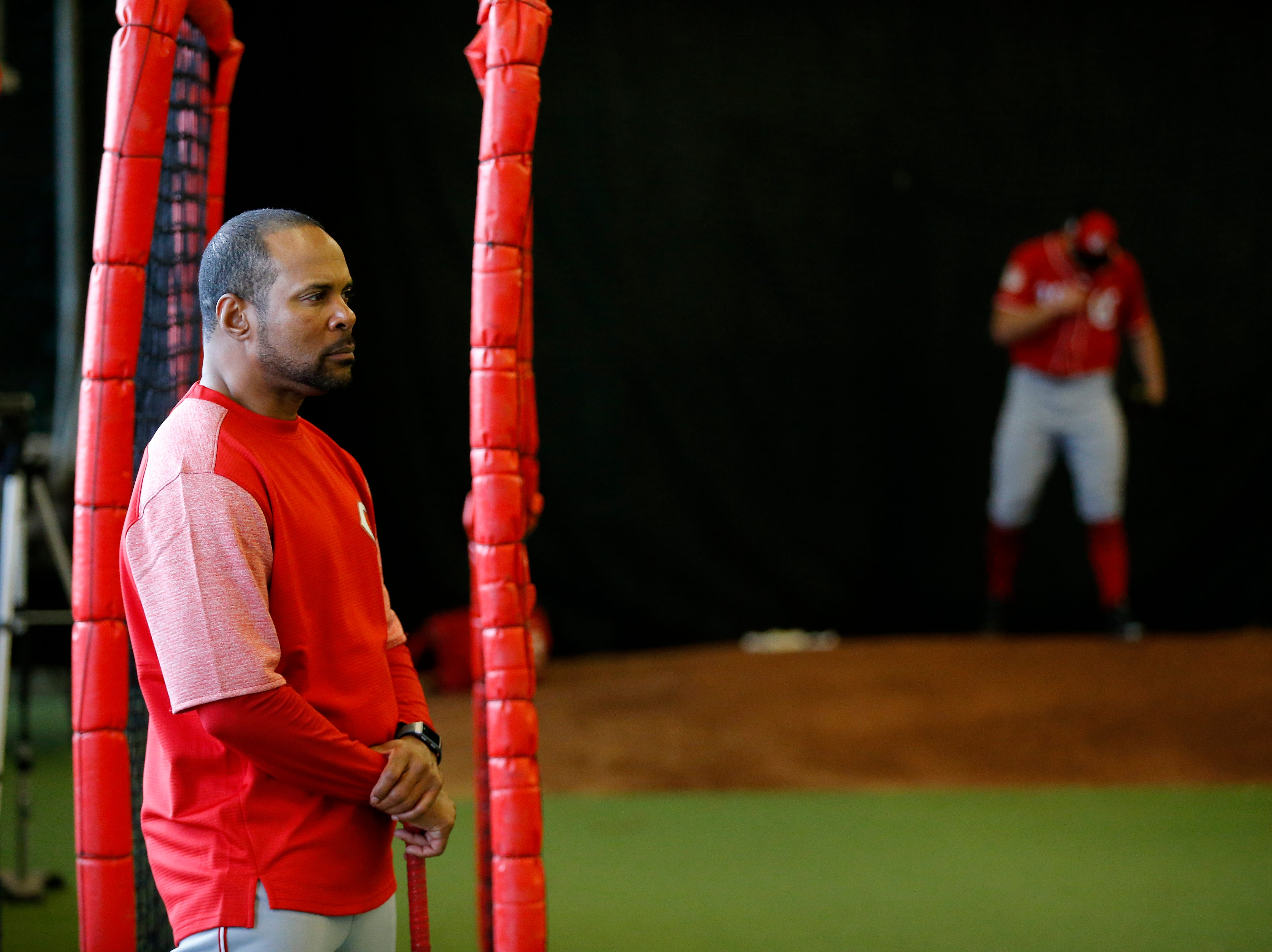 Barry Larkin watches pitching drills at the Cincinnati Reds spring training facility in Goodyear, Ariz., on Thursday, Feb. 21, 2019.