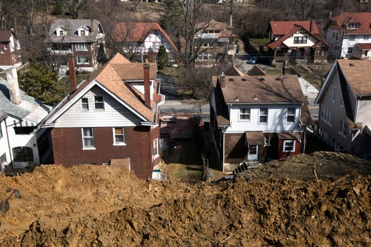 A view from the top of a recent landslide in North Avondale. The landslide pushed dirt and debris against the houses at the bottom of the hill, threatening serious structural damage.