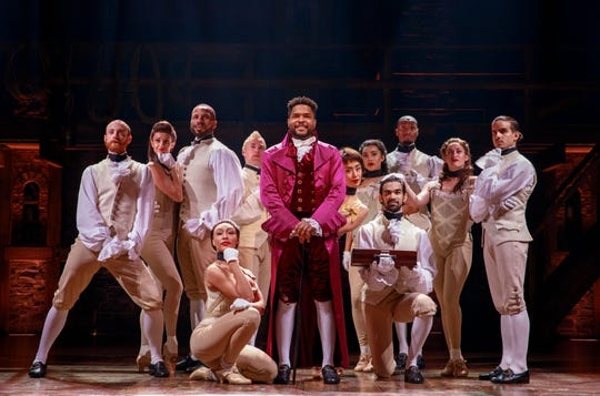 "Bryson Bruce, center, plays Thomas Jefferson in the National Tour of Lin-Manuel Miranda's ""Hamilton: An American Musical,"" which runs through March 10 at Cincinnati's Aronoff Center. The show will be here as part of the Broadway in Cincinnati series."
