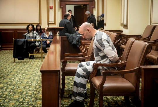Jacob Goodwin waits to be sentenced by Hamilton County Common Pleas Judge Tom Heekin Thursday, February 21, 2019 in the Hamilton County Courthouse in Downtown Cincinnati. Goodwin, a onetime police officer in Newtown, Aberdeen and then Elmwood Place, committed five robberies in a one-month span in 2017 to feed an addiction to prescription pills. Elmwood Place fired him after records say he was found unconscious at his desk by a fellow officer. Goodwin's attorneys said he developed his addiction after an on-duty injury while working in Aberdeen.