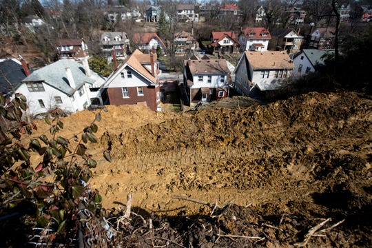 A landslide in 2018 affected several homes in North Avondale. The neighbors at the top and bottom of the slide agreed to share repair costs.