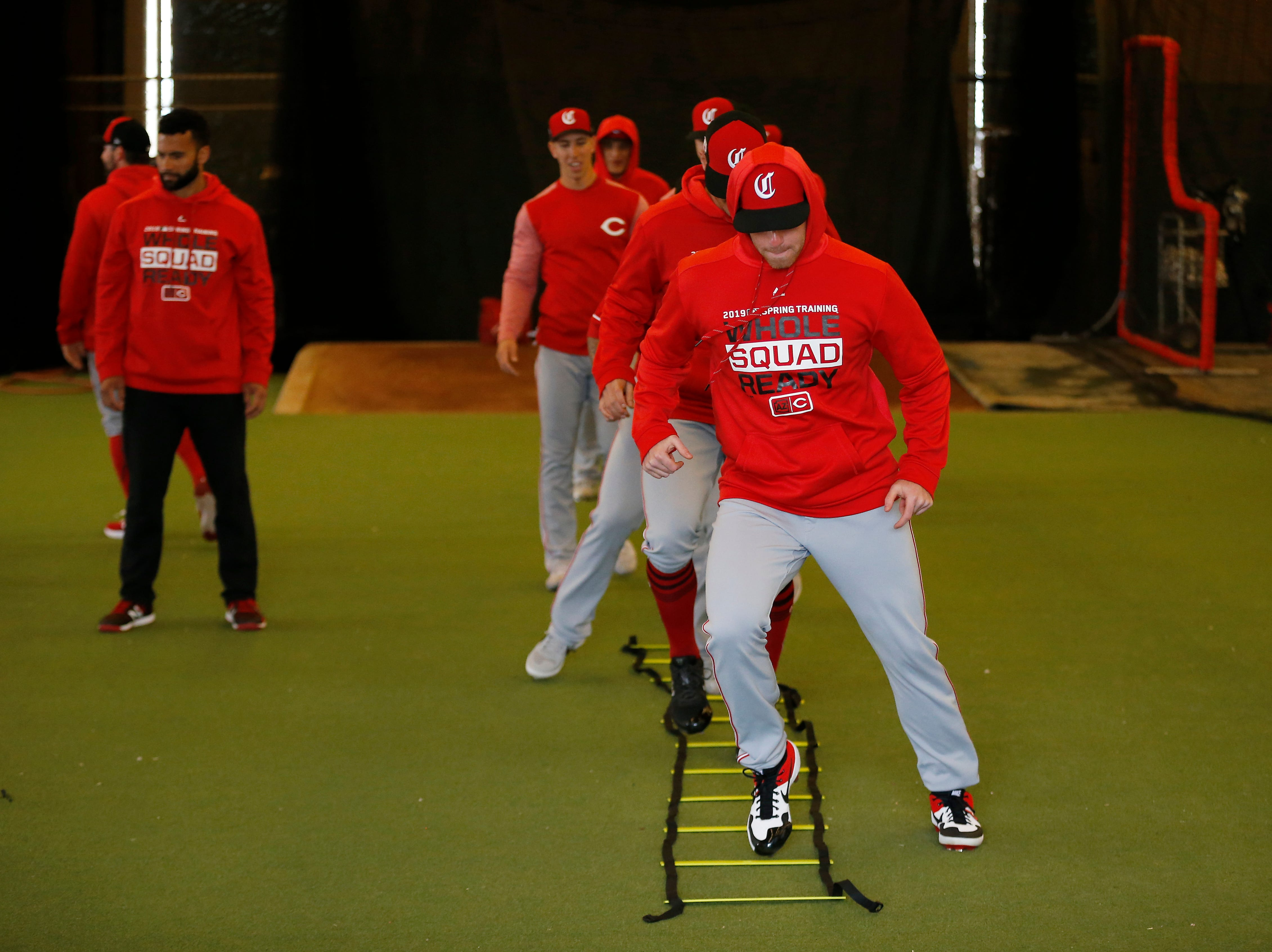 Pictures warm up through ladder drills at the Cincinnati Reds spring training facility in Goodyear, Ariz., on Thursday, Feb. 21, 2019.