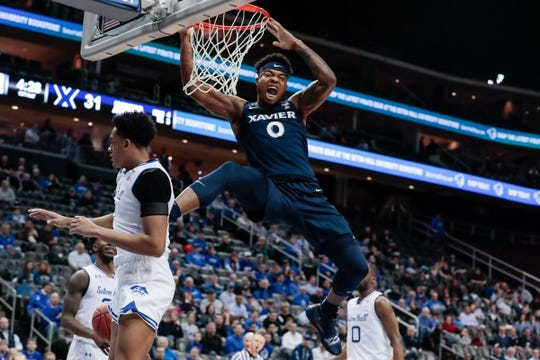 Xavier Musketeers forward Tyrique Jones (0) dunks the ball in front of Seton Hall Pirates guard Quincy McKnight (0) during the first half at Prudential Center.