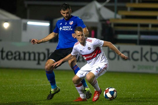 Chicago Fire forward Fabian Herbers (21) attempts to maintain control of the ball against FC Cincinnati midfielder Nazmi Albadawl (5) during the first half at MUSC Health Stadium.