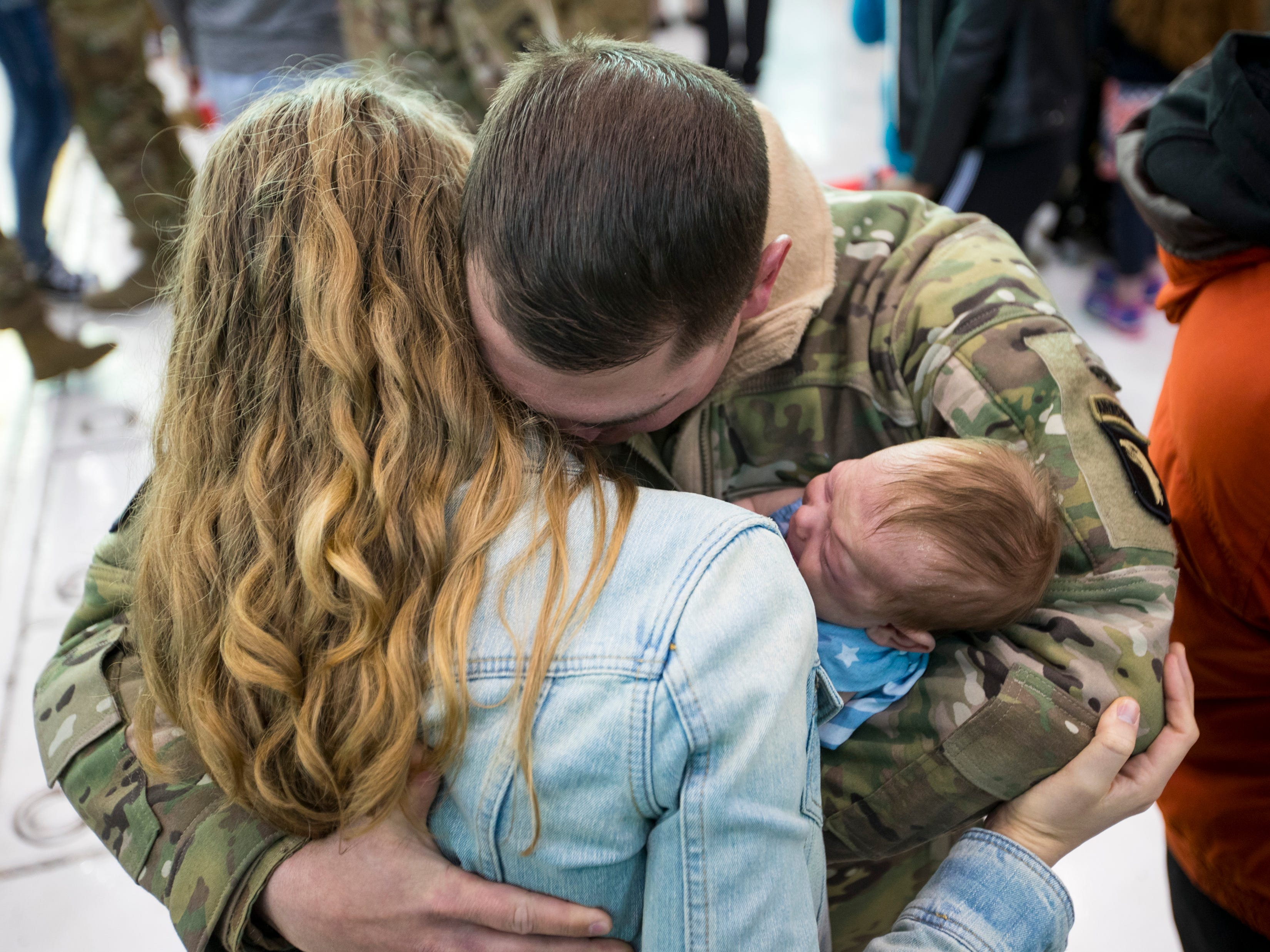 Staff Sgt. R.J. Paski hugs his wife Sarah Paski and his newborn Gianna Paski, 2 months, during a homecoming ceremony for members of the 101st Combat Aviation Brigade and 101st Sustainment Brigade at Fort Campbell in Clarksville on Thursday, Feb. 21, 2019. It was the first time Staff Sgt. Paski held his daughter. The soldiers were returning from a nine-month deployment to Afghanistan.