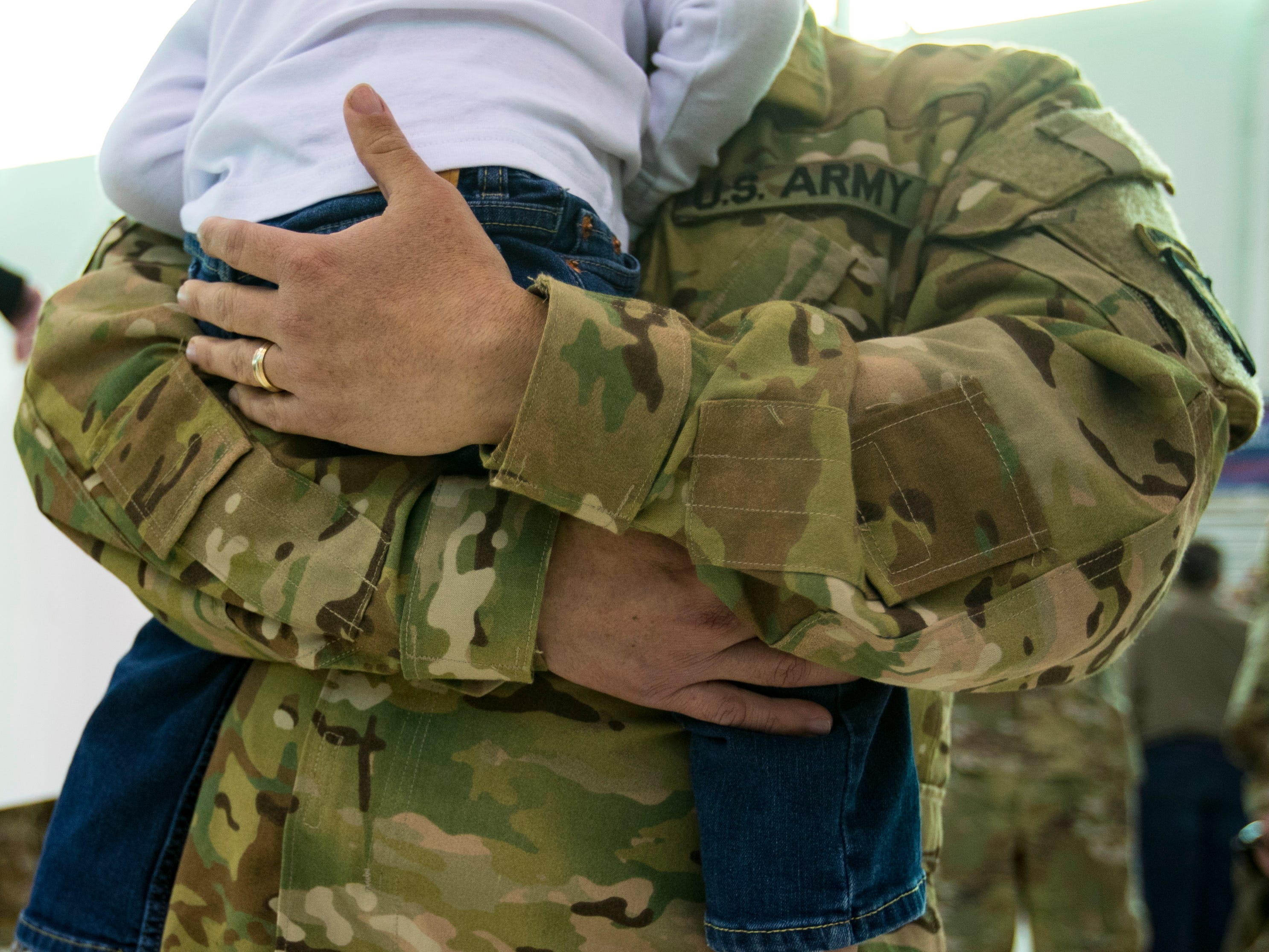 Gustavo Canales holds Raul Canales, 3, during a homecoming ceremony for members of the 101st Combat Aviation Brigade and 101st Sustainment Brigade at Fort Campbell in Clarksville on Thursday, Feb. 21, 2019. The soldiers were returning from a nine-month deployment to Afghanistan.