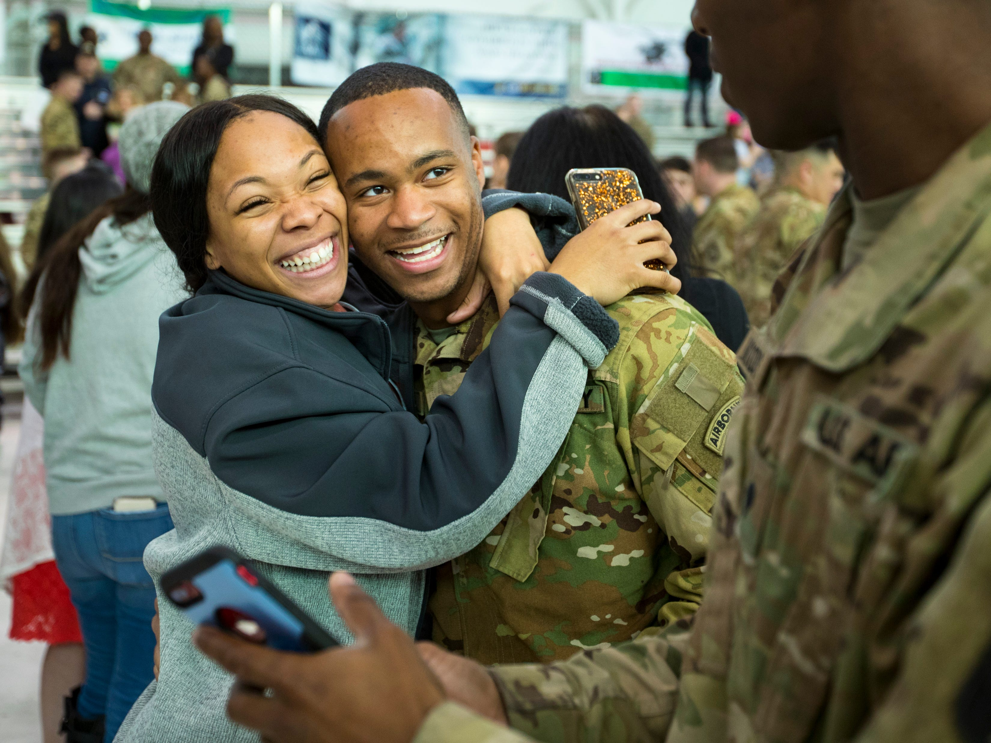 Tiara Patterson holds Spc. Curtis Keaton during a homecoming ceremony for members of the 101st Combat Aviation Brigade and 101st Sustainment Brigade at Fort Campbell in Clarksville on Thursday, Feb. 21, 2019. The soldiers were returning from a nine-month deployment to Afghanistan.