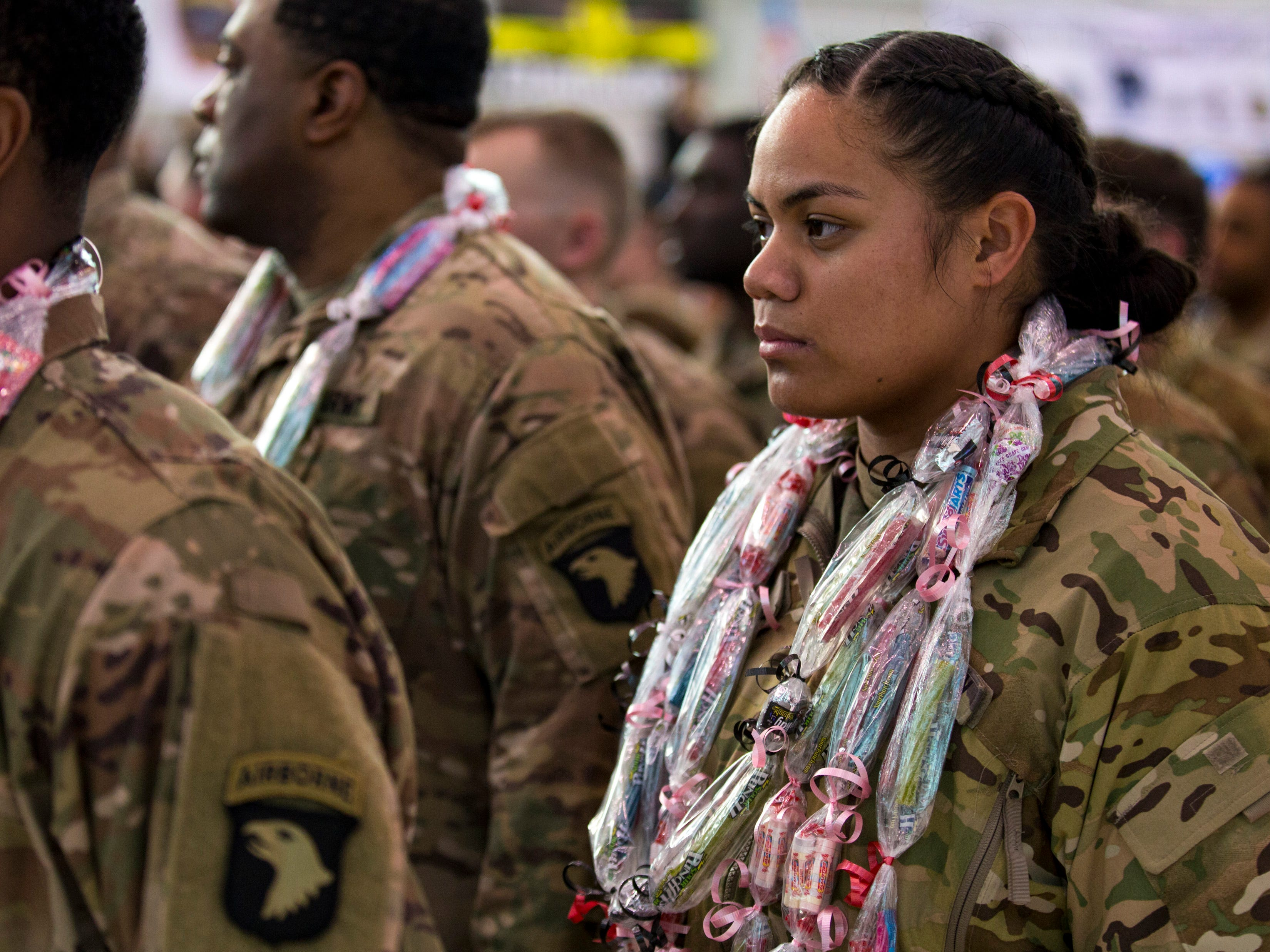 Leama Abelene wears a necklace made of candy given to her by her family during a homecoming ceremony for members of the 101st Combat Aviation Brigade and 101st Sustainment Brigade at Fort Campbell in Clarksville on Thursday, Feb. 21, 2019. The soldiers were returning from a nine-month deployment to Afghanistan.