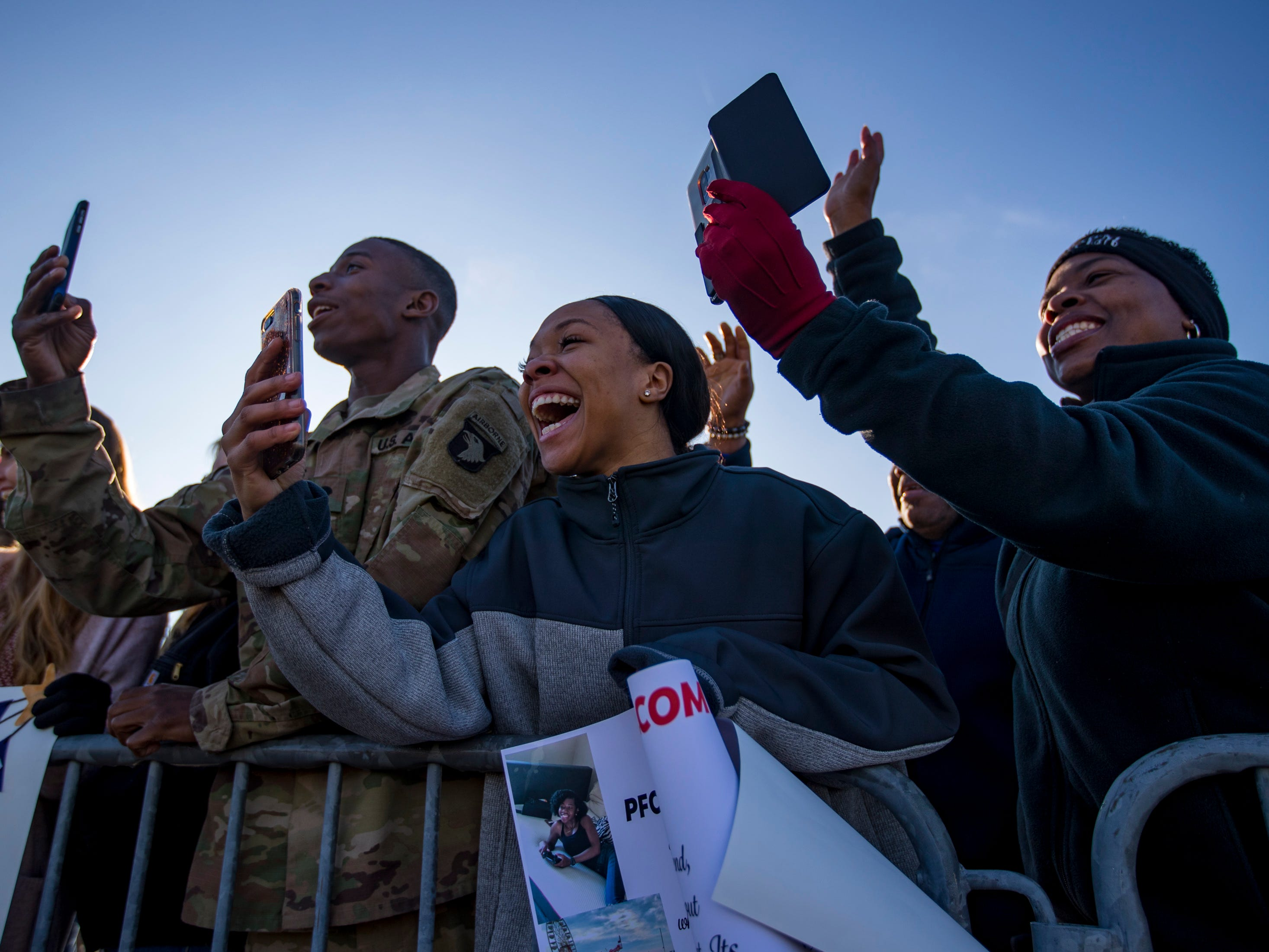 Tiara Patterson cheers as she sees her boyfriend Spc. Curtis Keaton during a homecoming ceremony for members of the 101st Combat Aviation Brigade and 101st Sustainment Brigade at Fort Campbell in Clarksville on Thursday, Feb. 21, 2019. The soldiers were returning from a nine-month deployment to Afghanistan.