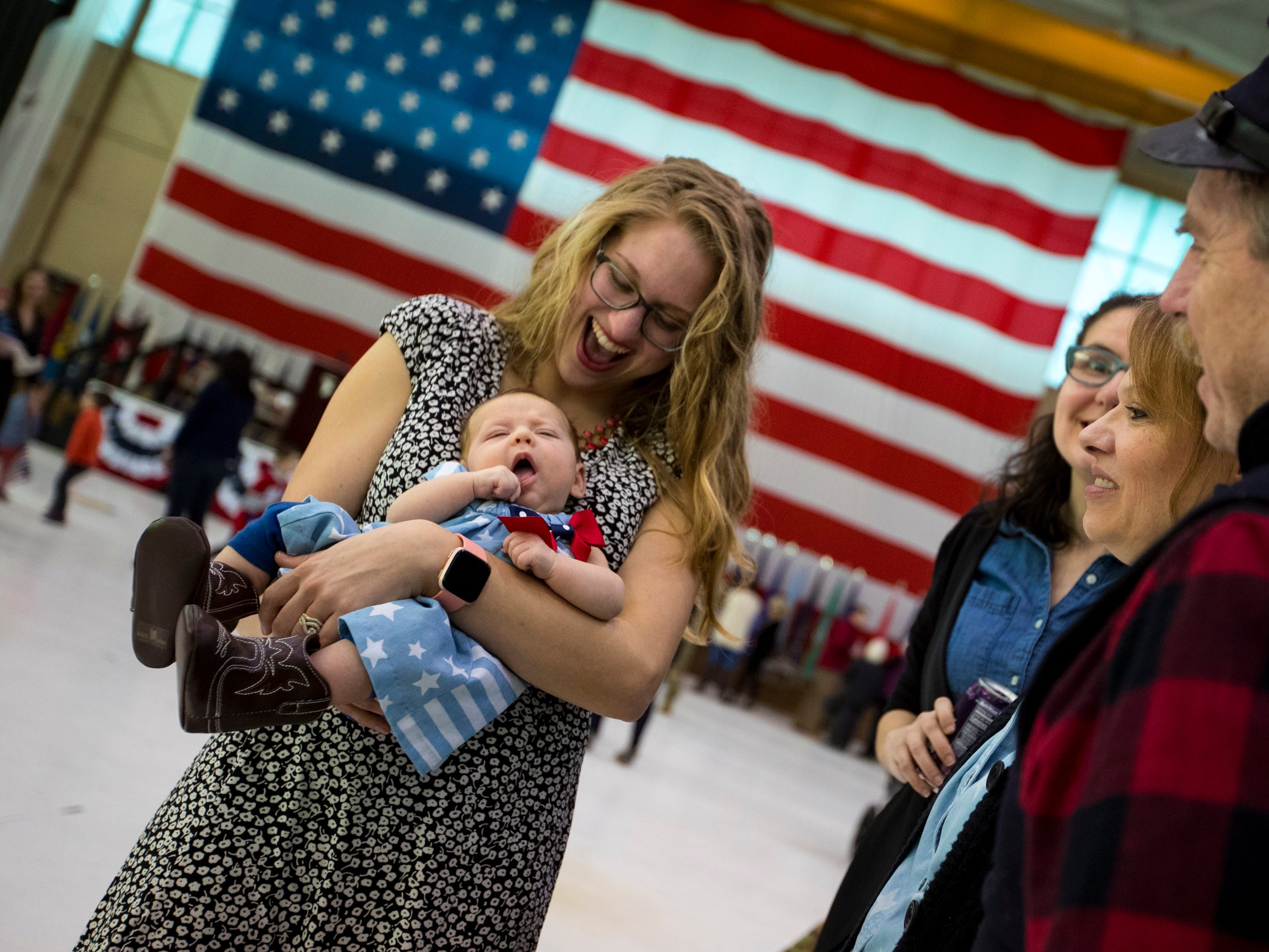 Sarah Paski holds Gianna Paski, 2 months, during a homecoming ceremony for members of the 101st Combat Aviation Brigade and 101st Sustainment Brigade at Fort Campbell in Clarksville on Thursday, Feb. 21, 2019. The ceremony was the first time Gianna Paski would meet her father, Staff Sgt. R.J. Paski. The soldiers were returning from a nine-month deployment to Afghanistan.