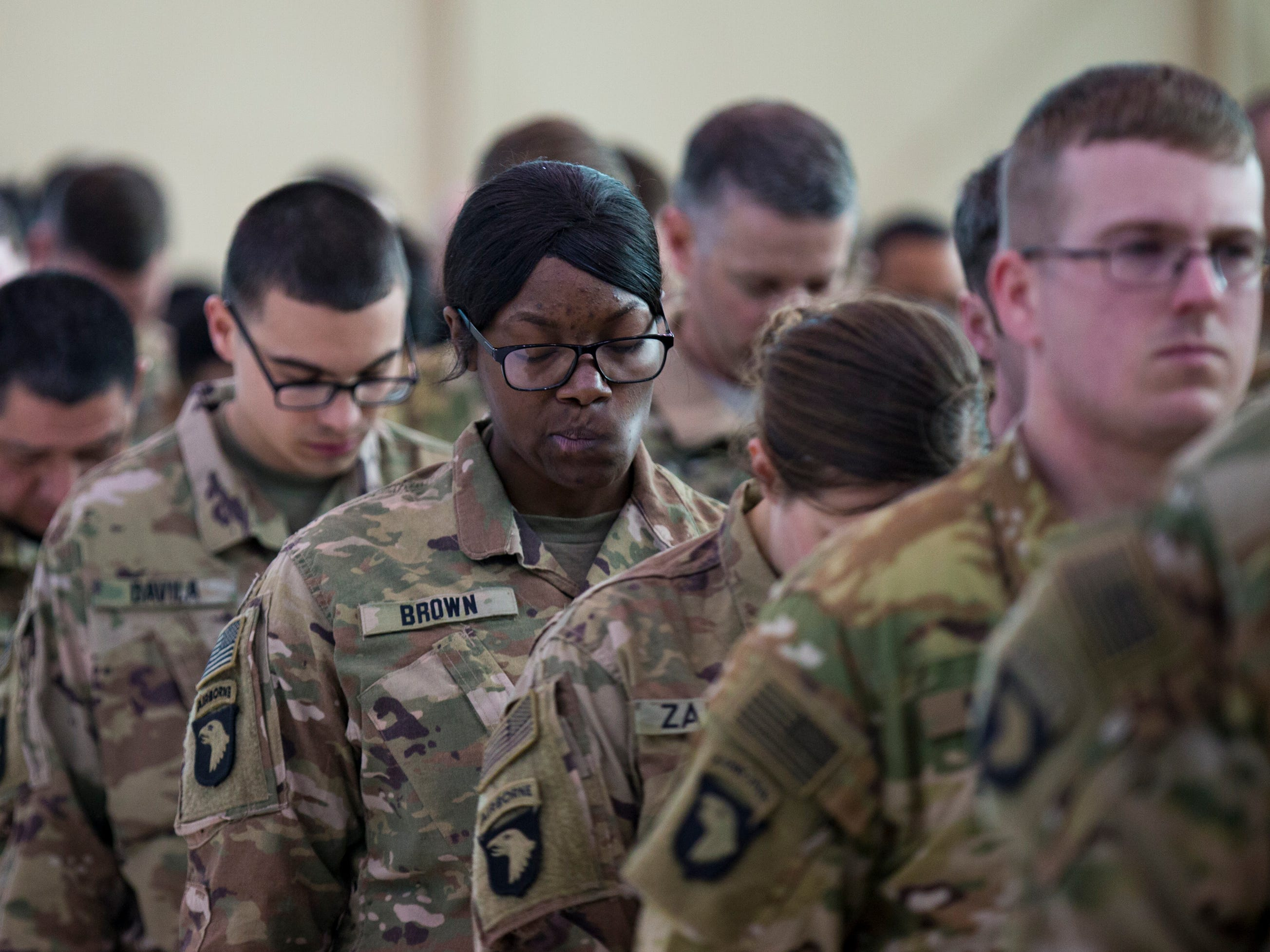 Soldiers bow their head as a short prayer is said during a homecoming ceremony for members of the 101st Combat Aviation Brigade and 101st Sustainment Brigade at Fort Campbell in Clarksville on Thursday, Feb. 21, 2019. The soldiers were returning from a nine-month deployment to Afghanistan.