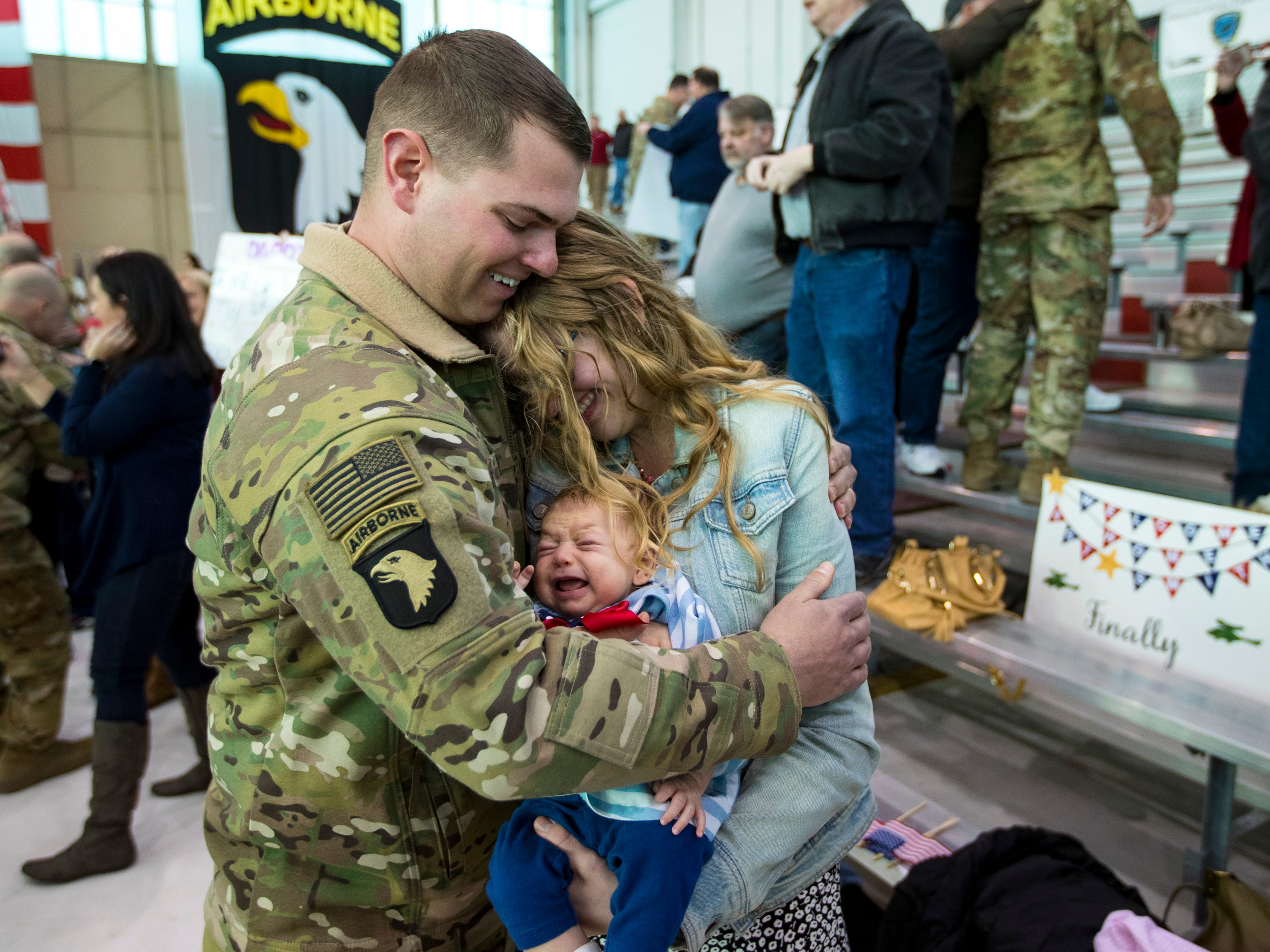 Staff Sgt. R.J. Paski holds his wife Sarah Paski and his newborn Gianna Paski, 2 months, during a homecoming ceremony for members of the 101st Combat Aviation Brigade and 101st Sustainment Brigade at Fort Campbell in Clarksville on Thursday, Feb. 21, 2019. The soldiers were returning from a nine-month deployment to Afghanistan.