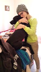 Tamariah Tower posted photos of her dog Roscoe after his death, including this one of her giving him a hug.