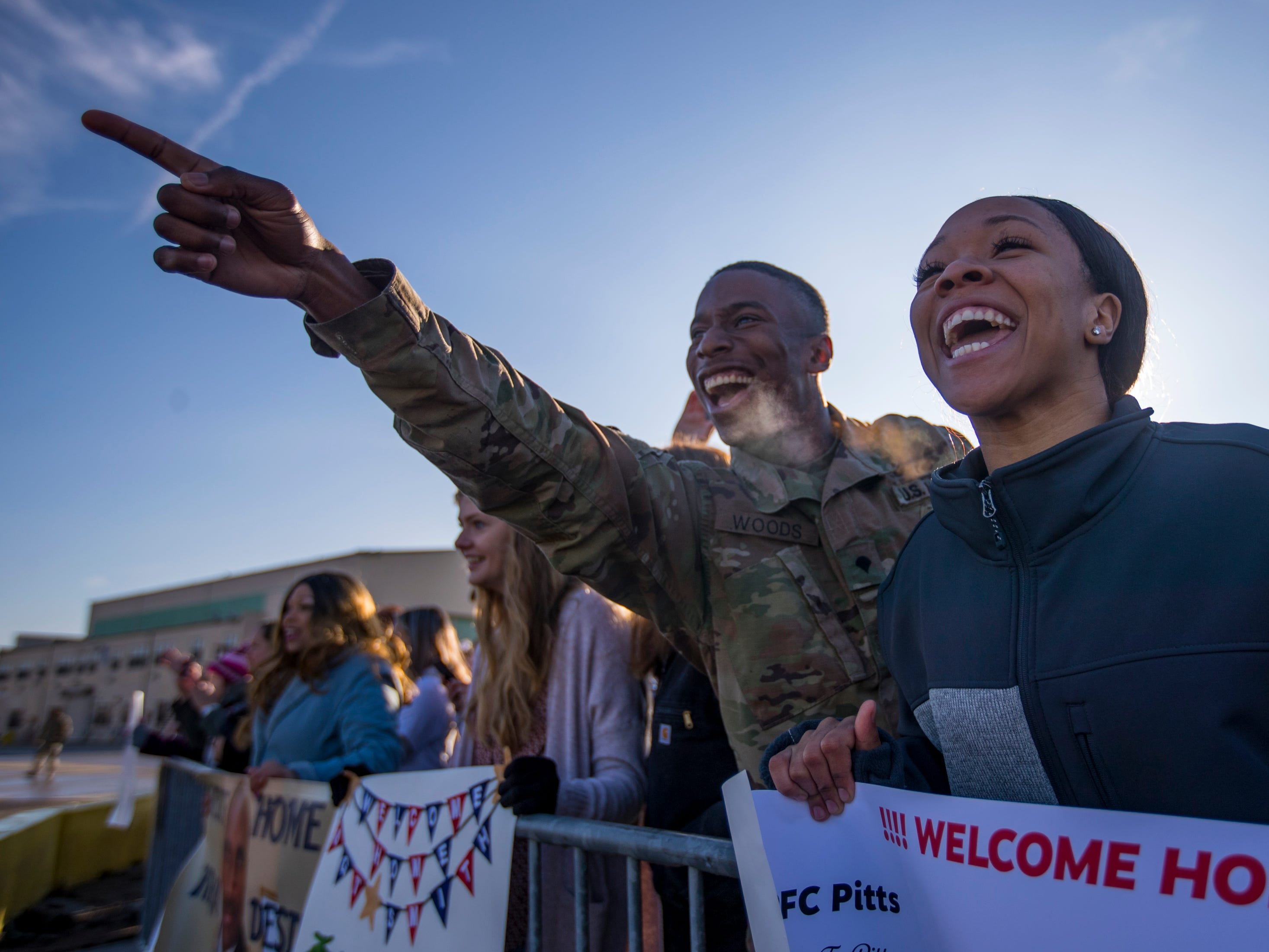 Spc. Woodrow Woods IV points out Spc. Curtis Keaton as he deplanes, while Keaton's girlfriend, Tiara Patterson, cheers during a homecoming ceremony for members of the 101st Combat Aviation Brigade and 101st Sustainment Brigade at Fort Campbell in Clarksville on Thursday, Feb. 21, 2019. The soldiers were returning from a nine-month deployment to Afghanistan.