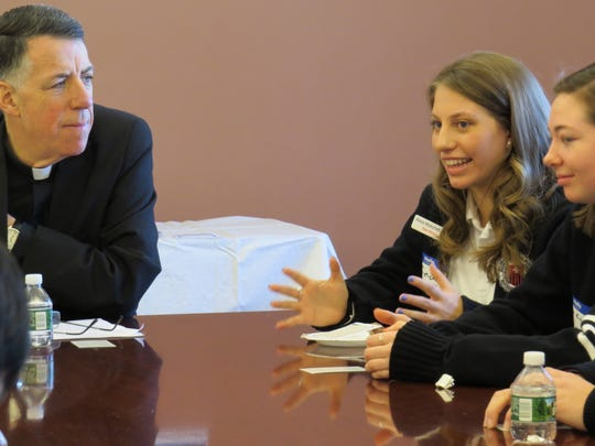 Fifteen Catholic high school students met with Bishop James F. Checchio for a Jan. 31 listening session at the Saint John Neumann Pastoral Center in Piscataway.