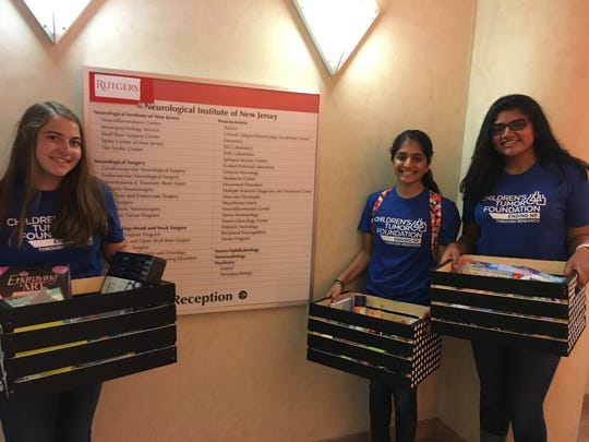 (Left to right) Michelle Masiello of Hillsborough, Mira Amin of Bridgewater and Ritu Peddinti of Bridgewater deliver baskets as part of their community service project at Rutgers New Jersey Medical School at the University Hospital in Newark.