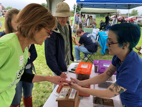 Sourland Conservancy Executive Director Caroline Katmann enjoys one of the many hands-on activities available at partner booths in the 2018 Cool Critters area of the former Sourland Music Festival. The event, which will return June 22 to Hillsborough Golf & Country Club, has changed its name to Sourland Mountain Festival, but still remain a fundraiser for Sourland Conservancy, a nonprofit dedicated to the protection of the mountain region and its wildlife.