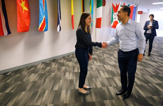Julian Castro, former U.S. Secretary of Housing and Urban Development and candidate for the 2020 Democratic presidential nomination, talks with student Karen Ruiz Arias, left, before a town hall meeting at Grand View University, Thursday, Feb. 21, 2019, in Des Moines, Iowa. (AP Photo/Charlie Neibergall)