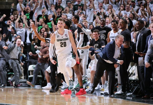 Matt McQuaid #20 of the Michigan State Spartans celebrates his three-point basket in the second half against the Rutgers Scarlet Knights at Breslin Center on February 20, 2019 in East Lansing, Michigan.