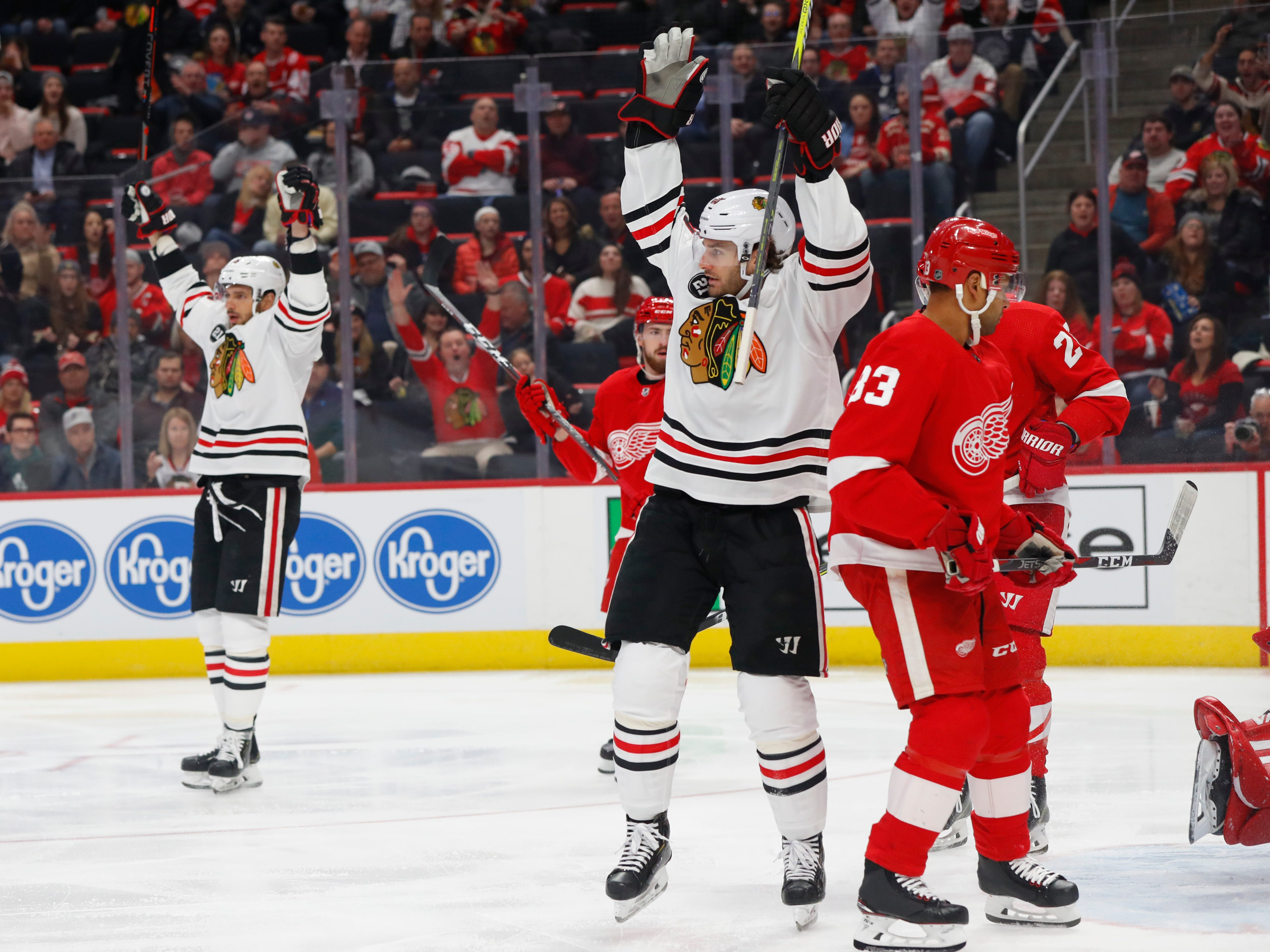 Chicago Blackhawks center Artem Anisimov, left, celebrates his goal with Brandon Saad, center, against the Detroit Red Wings in the first period of an NHL hockey game Wednesday, Feb. 20, 2019, in Detroit.