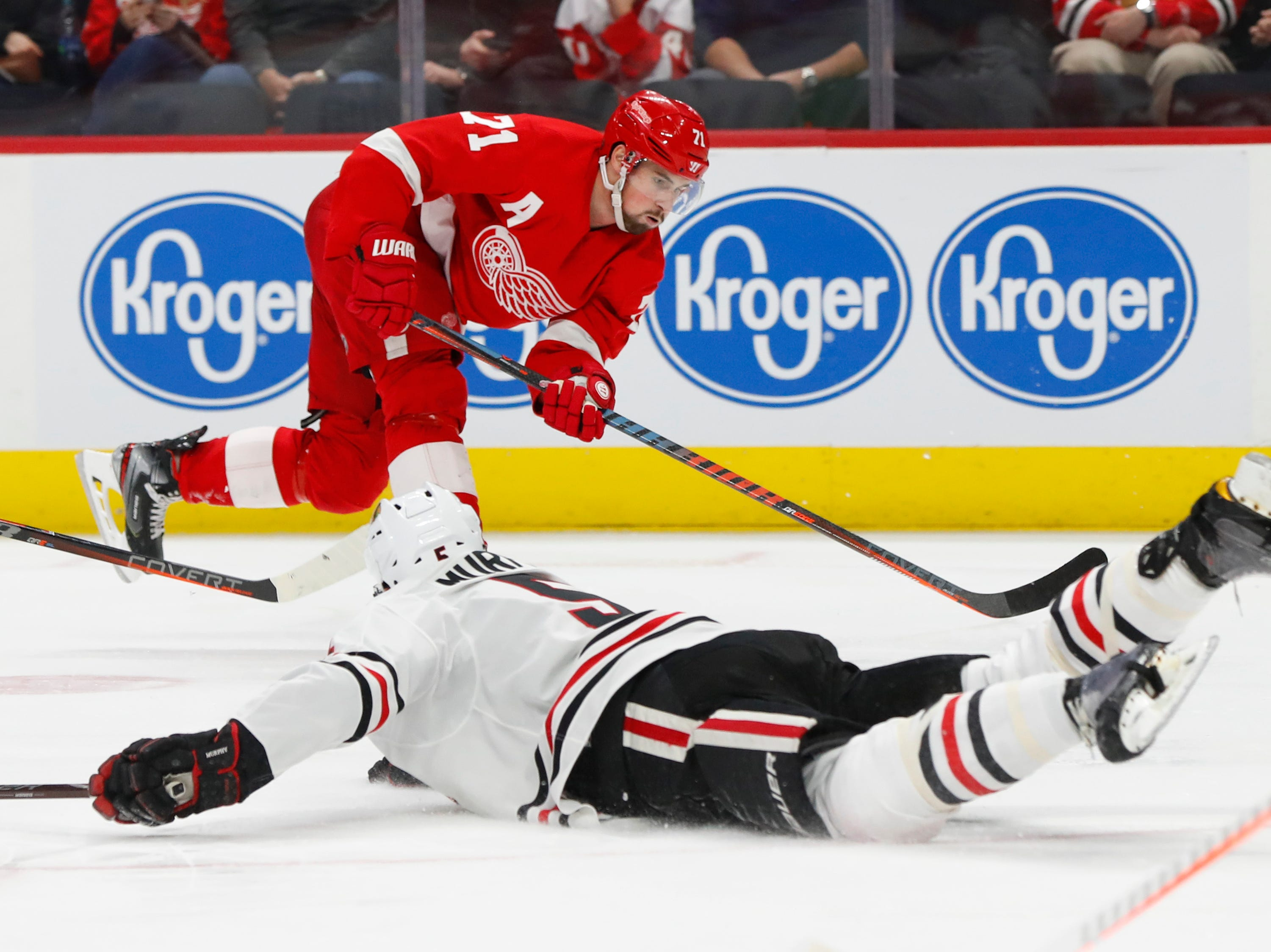 Chicago Blackhawks defenseman Connor Murphy (5) blocks a Detroit Red Wings center Dylan Larkin (71) shot in the second period of an NHL hockey game Wednesday, Feb. 20, 2019, in Detroit.