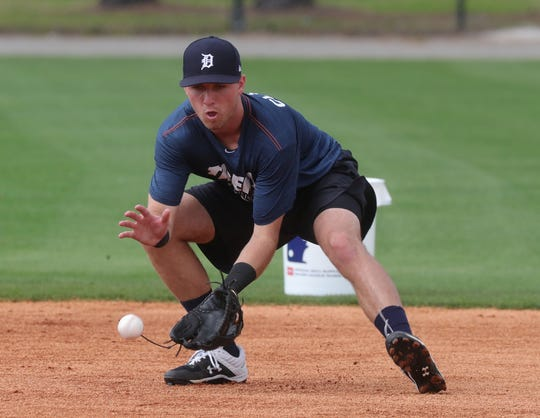 Tigers prospect Kody Clemons fields ground balls during spring training on Wednesday, Feb. 20, 2019, at Joker Marchant Stadium in Lakeland, Fla.