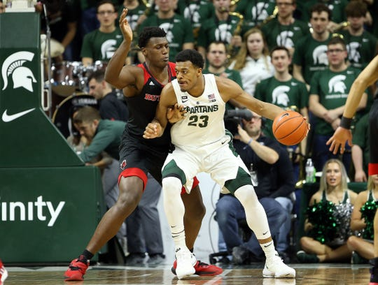 Michigan State Spartans forward Xavier Tillman (23) is defended by Rutgers Scarlet Knights center Myles Johnson (15) during the first half of a game at the Breslin Center on Feb. 20, 2019.