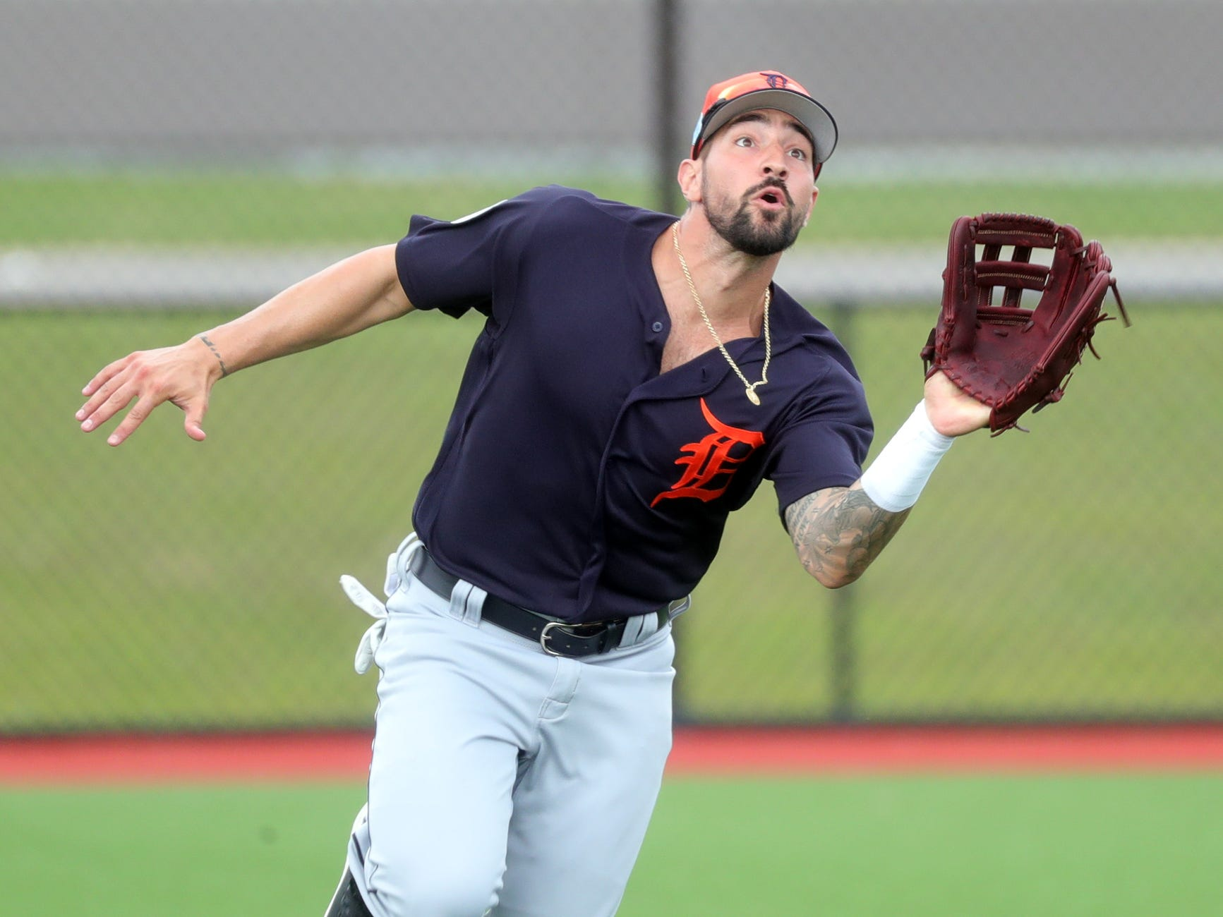 Tigers outfielder Nicholas Castellanos catches a fly ball during spring training on Wednesday, Feb. 20, 2019, at Joker Marchant Stadium in Lakeland, Fla.