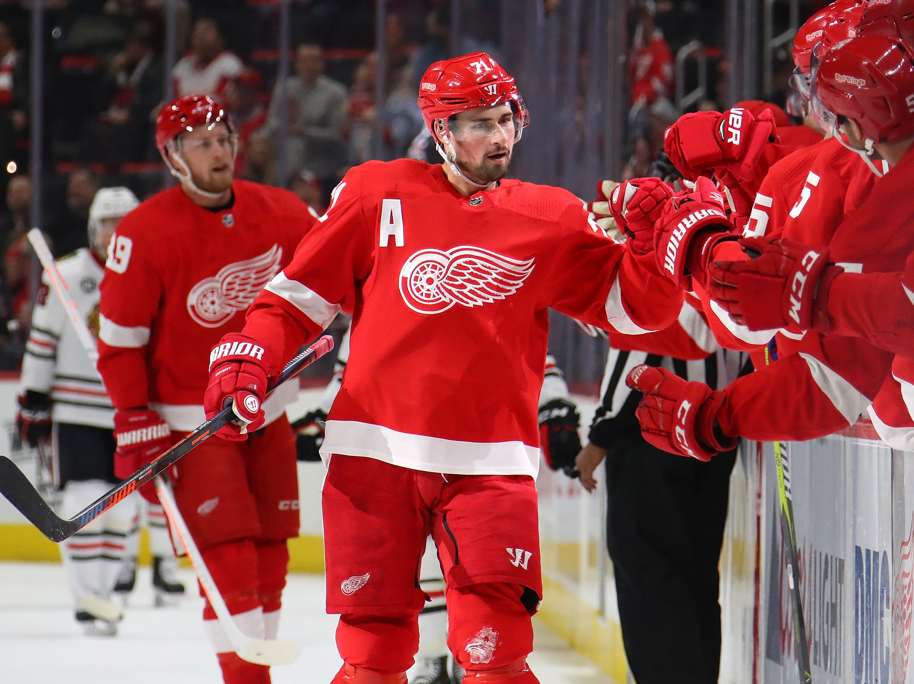 Dylan Larkin #71 of the Detroit Red Wings celebrates his first period goal with teammates while playing the Chicago Blackhawks at Little Caesars Arena on February 20, 2019 in Detroit, Michigan.