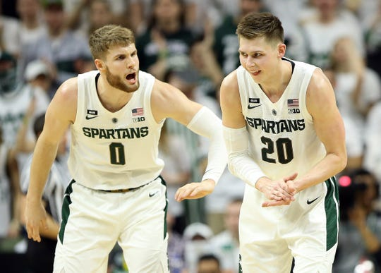 Michigan State guard Matt McQuaid and forward Kyle Ahrens react during the second half of the 71-60 win over Rutgers on Wednesday, Feb. 20, 2019, at the Breslin Center.