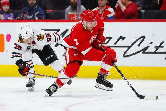 Nick Jensen skates with the puck against the Blackhawks, Wednesday, Feb. 20, in Detroit.