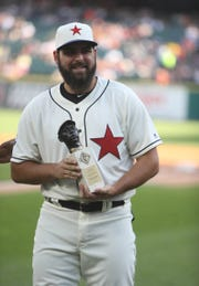 Detroit Tigers pitcher Michael Fulmer was presented with the Larry Doby Legacy Award by the Negro League Museum before action against the Cleveland Indians on July 1, 2017 at Comerica Park in Detroit.