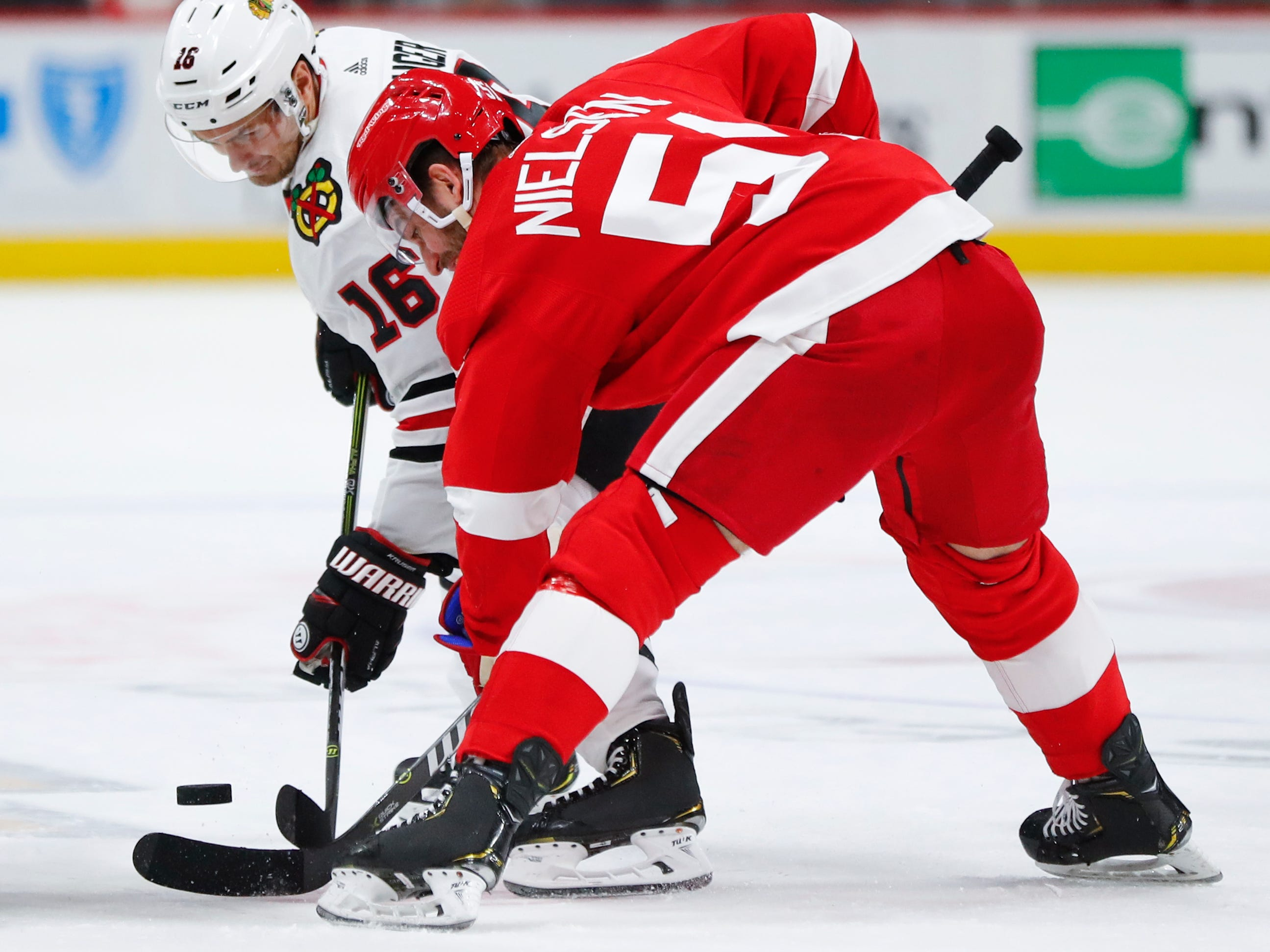 Chicago Blackhawks center Marcus Kruger (16) and Detroit Red Wings center Frans Nielsen (51) battle for the puck in the first period of an NHL hockey game Wednesday, Feb. 20, 2019, in Detroit.