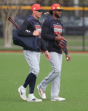 Tigers outfielders JaCoby Jones and Niko Goodrum walk to the practice fields during spring training Wednesday, Feb. 20, 2019, at Joker Marchant Stadium in Lakeland, Fla.