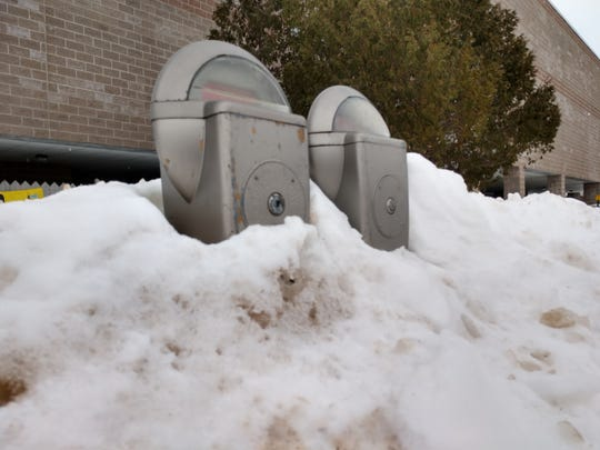 Several parking meters in downtown Sault Ste. Marie are buried in snow banks. The city's street department continued to clean snow as it fell for almost every day for a month.