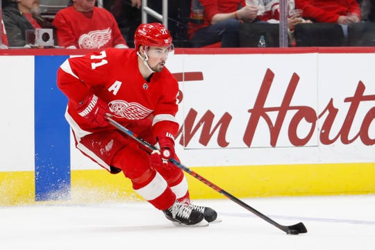 Detroit Red Wings center Dylan Larkin (71) skates with the puck during the first period against the Chicago Blackhawks at Little Caesars Arena on Feb. 20, 2019.