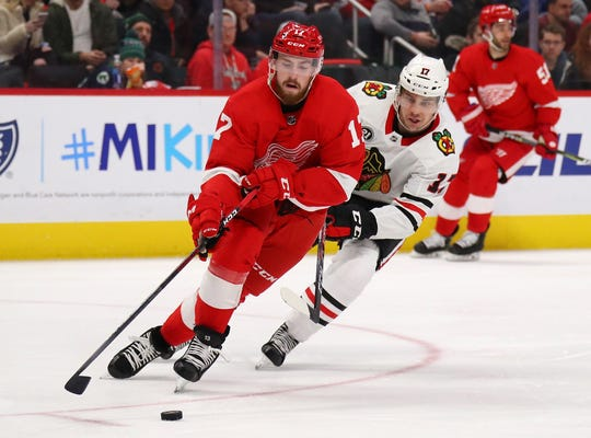 Red Wings defenseman Filip Hronek tries to get around the stick of the Blackhawks' Dylan Strome during the third period of the Wings' 5-4 loss on Wednesday, Feb. 20, 2019, at Little Caesars Arena.