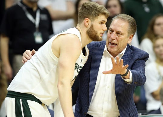 Michigan State coach Tom Izzo talks to forward Kyle Ahrens during the second half of the 71-60 win over Rutgers on Wednesday, Feb. 20, 2019, at the Breslin Center.