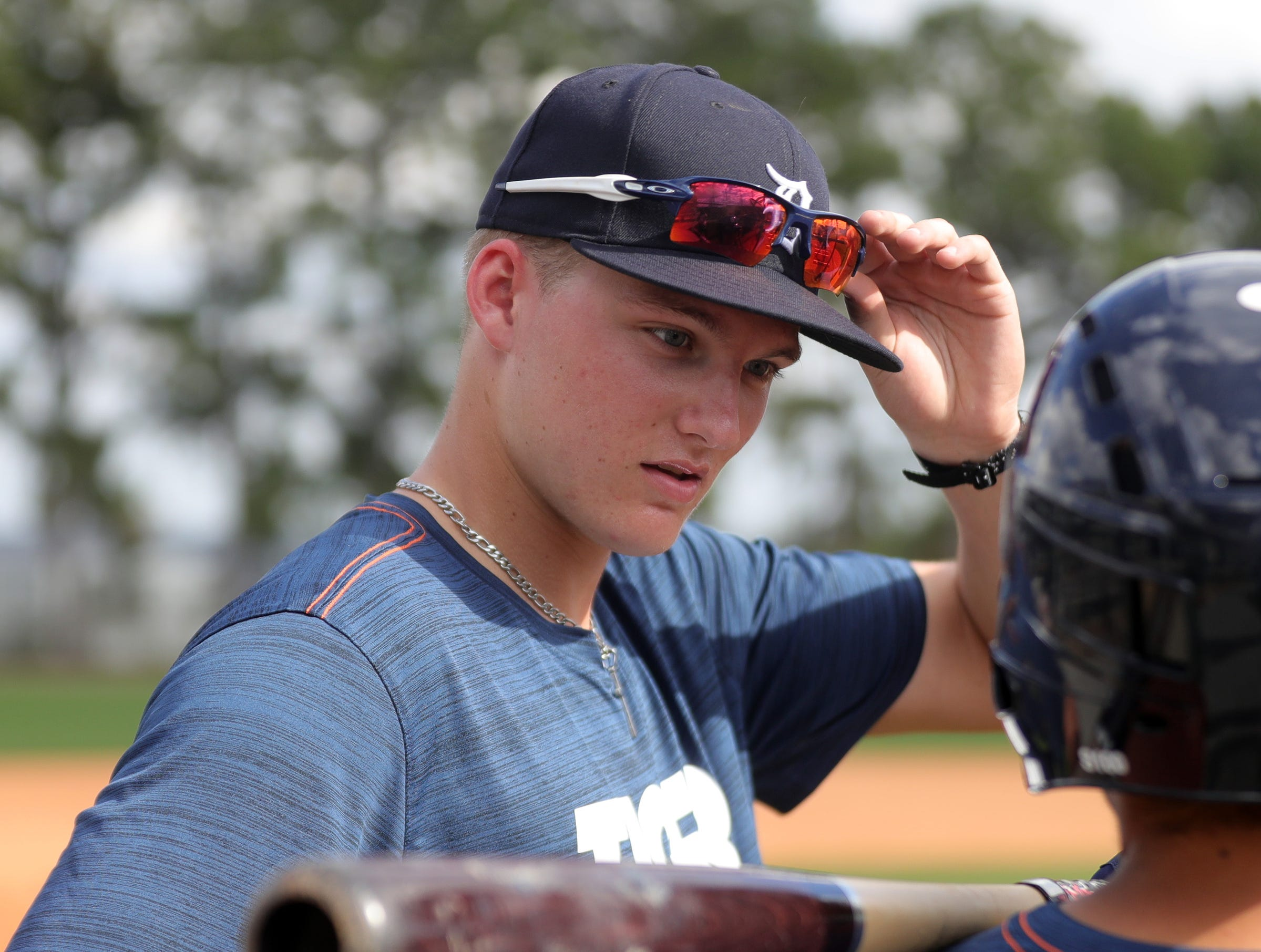 Tigers outfield prospect Parker Meadows talks with a teammate during spring training Wednesday, Feb. 20, 2019, at Joker Marchant Stadium in Lakeland, Fla.