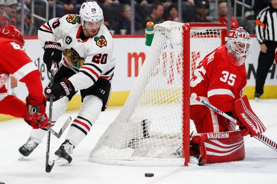 Chicago Blackhawks left wing Brandon Saad (20) skates behind the net against Detroit Red Wings goaltender Jimmy Howard (35) during the first period at Little Caesars Arena on Feb. 20, 2019.