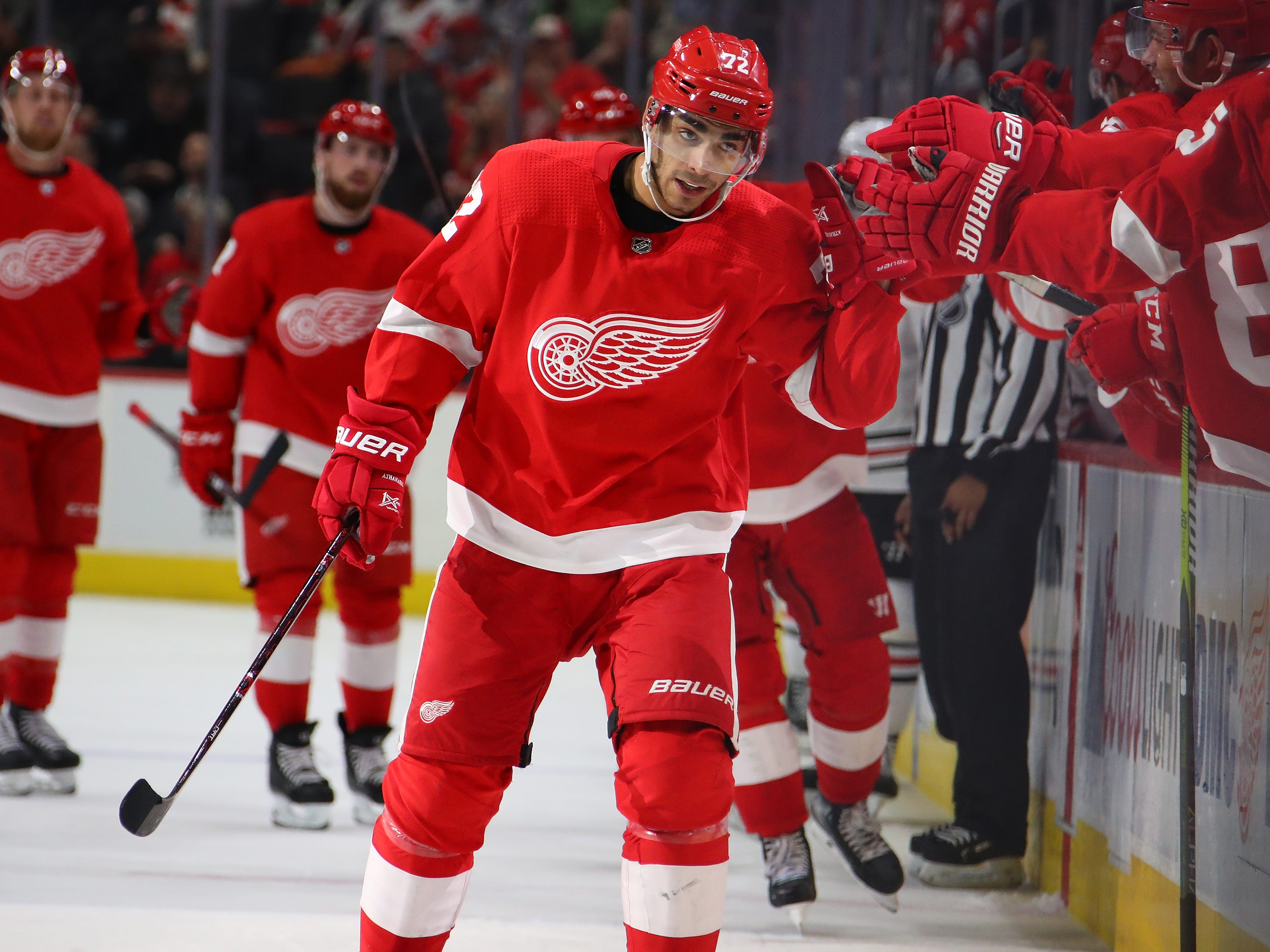 Red Wings forward Andreas Athanasiou celebrates his goal with teammates in the third period of the Wings' 5-4 loss on Wednesday, Feb. 20, 2019, at Little Caesars Arena.