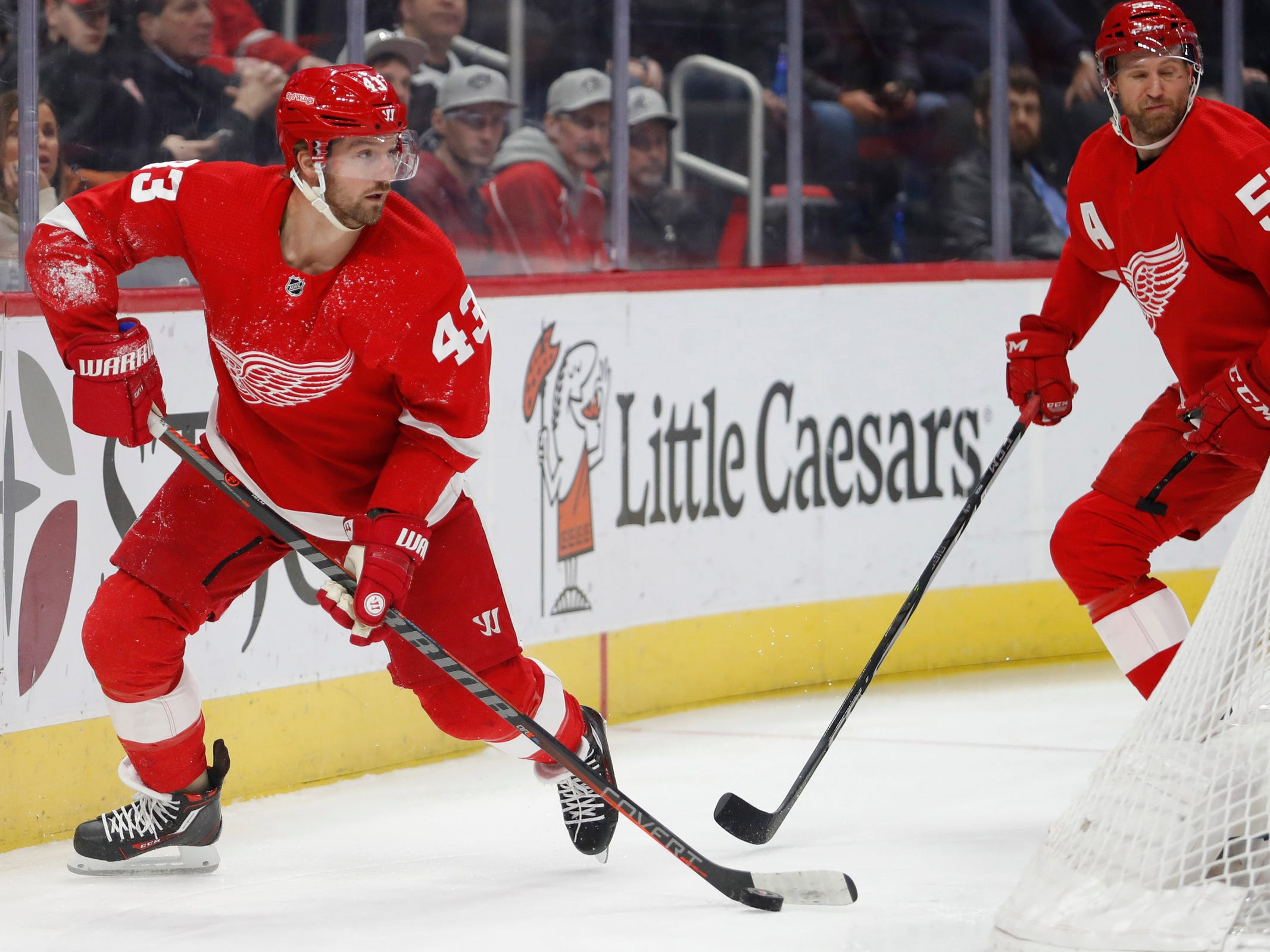 Detroit Red Wings left wing Darren Helm (43) looks for an open man during the first period against the Chicago Blackhawks at Little Caesars Arena on Feb. 20, 2019.