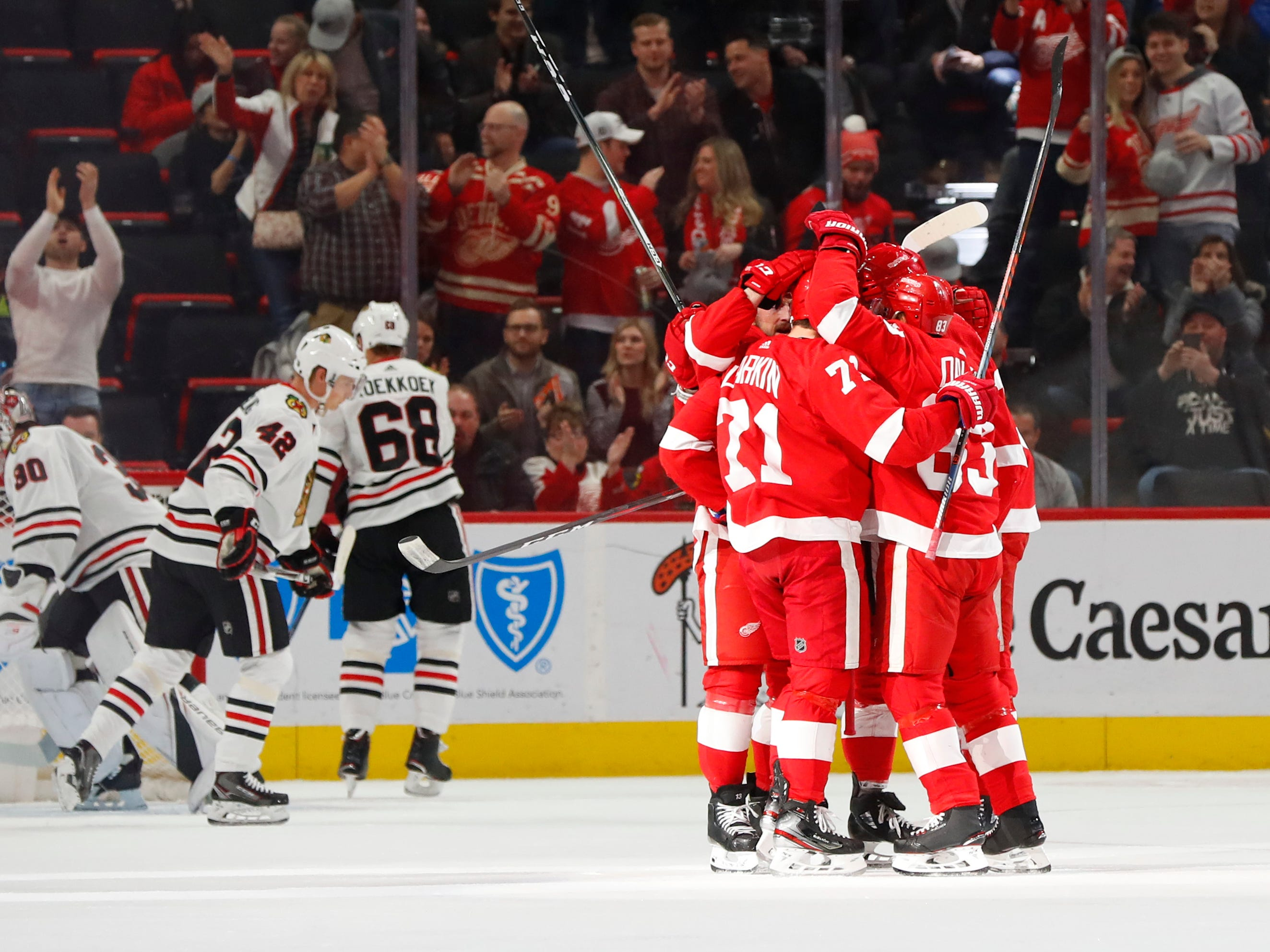 Detroit Red Wings center Dylan Larkin (71) celebrates his goal against the Chicago Blackhawks in the first period of an NHL hockey game Wednesday, Feb. 20, 2019, in Detroit.